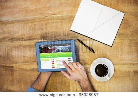 Gambling app screen against man working on tablet