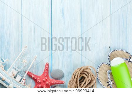 Travel and vacation background with items over wooden table. Top view with copy space