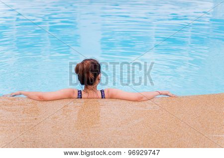 Young Woman With Swimsuit In Swimming Pool.