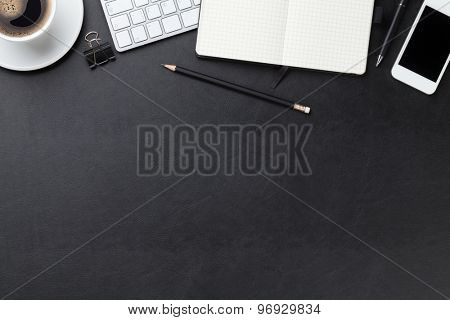 Office leather desk table with computer, supplies and coffee cup. Top view with copy space