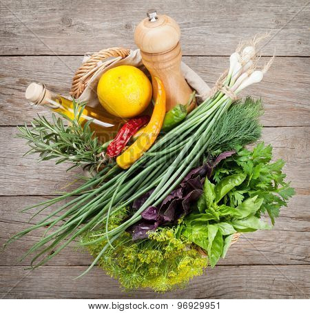 Fresh garden herbs and spices on wooden table