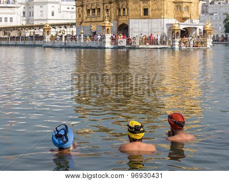 Sikhs Men Visiting The Golden Temple In Amritsar, Punjab, India.