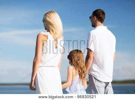 summer holidays, celebration, children and people concept - happy family at the seaside