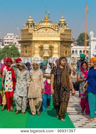 Sikh people visiting the Golden Temple in Amritsar, Punjab, India.