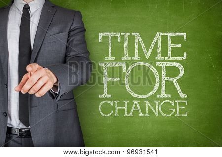 Time for change on blackboard with businessman