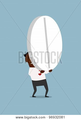 Black businessman carrying a huge pill