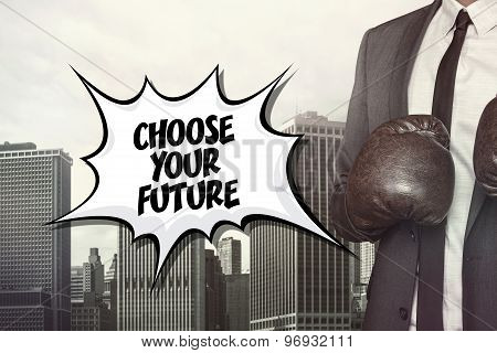 Choose your future text with businessman wearing boxing gloves