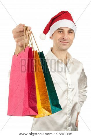 Young Men In Christmas Red Hat With Paper Presents Bags