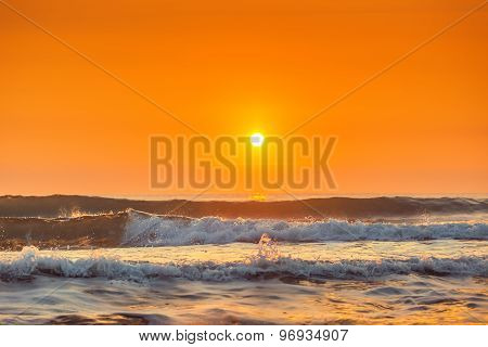 Sunrise And Shining Waves In Ocean