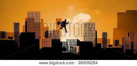Businessman stepping against cityscape stencil design
