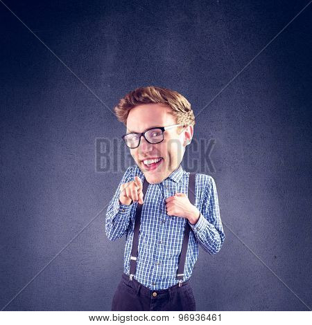 Geeky businessman pointing against grey room