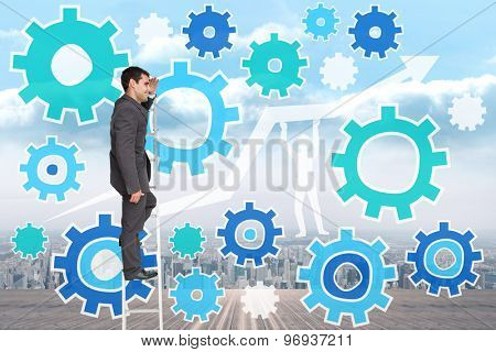 Happy businessman standing on ladder against city on the horizon