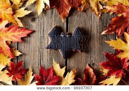 Halloween homemade gingerbread cookie over wooden background