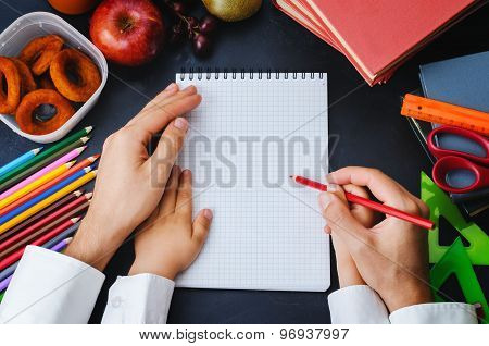 Mans Hand Holding A Childs Hand With Pencil. School Concept