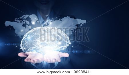 Businesswoman hold brain digital image on hand