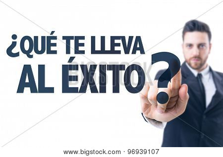 Business man pointing the text: Which Takes You to Success? (in Spanish)