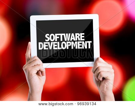 Tablet pc with text Software Development with bokeh background