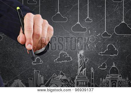 Businessman hand drawing dream travel around the world