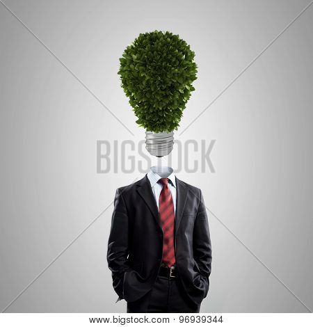 Businessman with light bulb instead of head