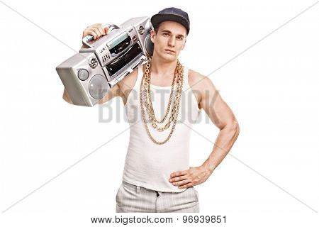 Young male rapper holding a ghetto blaster over his shoulder and looking at the camera isolated on white background