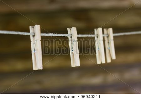 Wooden Clothespins On The Clothesline