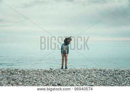 Traveler Girl Standing On Coast In Windy Weather