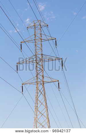Power Pole And Power Lines On Blue Sky Background
