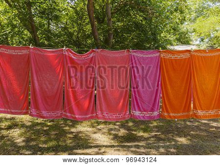Colourful Towels Hanging On A Rope In The Woods