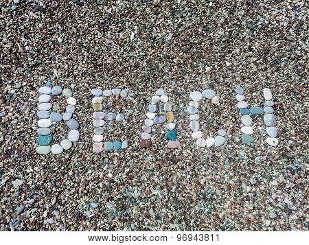 Beach Word From Stones On Pebble Beach