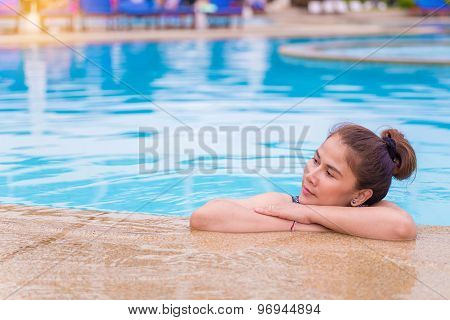 Woman With Swimsuit In Swimming Pool.