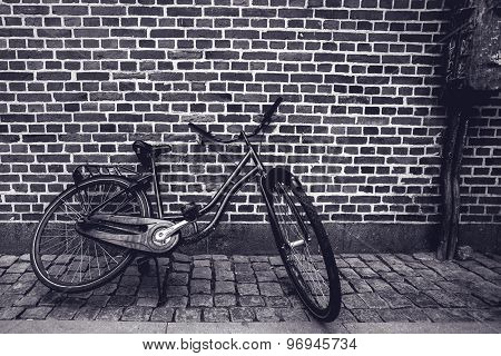 Unique Classic Vintage Hipster Bicycle Leaning Against The Street Wall