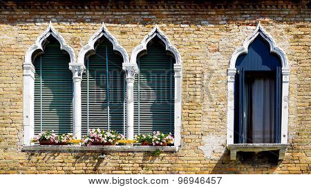 Four Windows In Arch Shape And Ancient Decay Brick Wall