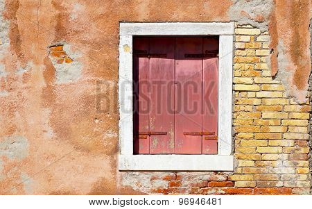 Red Window In White Frame And Ancient Decay Wall