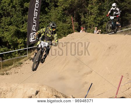 Detail Of Bikers On Jumps - Editorial