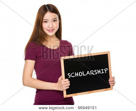 Young student hold with chalkboard showing a word scholarship