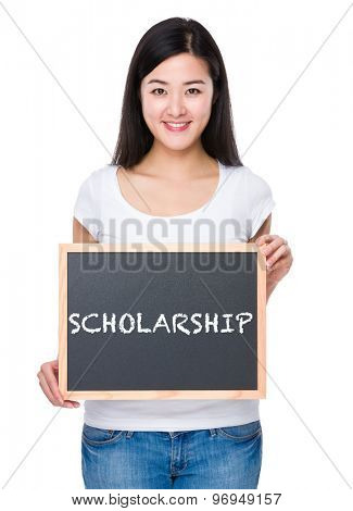 Student with chalkboard showing a word scholarship
