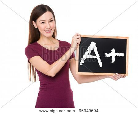 Asian woman with chalkboard showing A plus mark