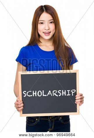 Young woman with black board showing a word of scholarship