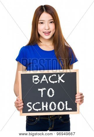 Young woman with black board showing phrase of back to school