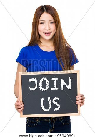 Young woman with black board showing phrase of join us
