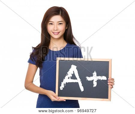 Asian woman with blackboard showing A plus mark