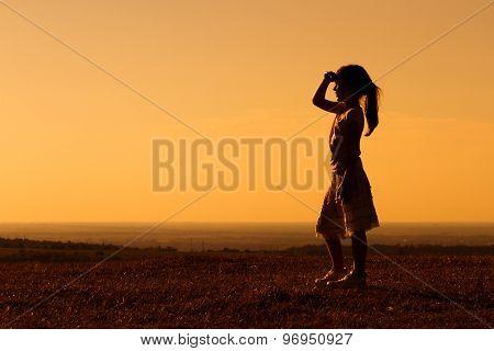 Little girl enjoys in sunset