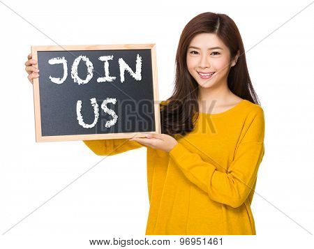 Young woman hand hold with the blackboard showing phrase of join us
