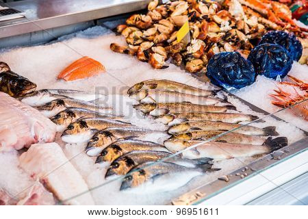 Various seafood on the shelves of the fish market in Norway, Bergen