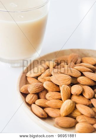 Almond Milk And Grain On White Kitchen Table