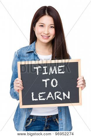 Young woman hold with chalkboard showing phrase of time to learn