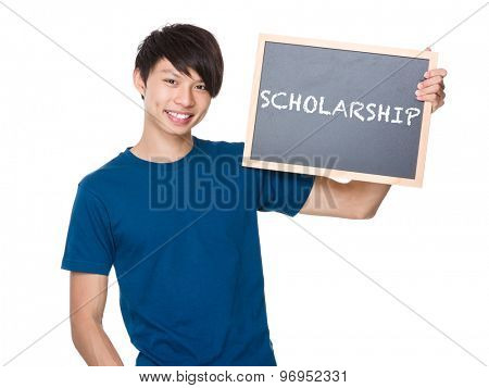 Asian man hold with blackboard and showing a word scholarship