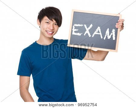 Asian man hold with blackboard and showing a word exam