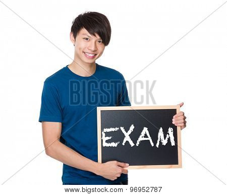 Asian man with the blackboard showing a word exam