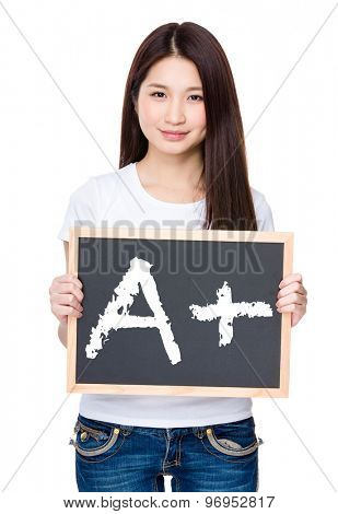 Asian young woman hold with chalkboard showing A plus mark